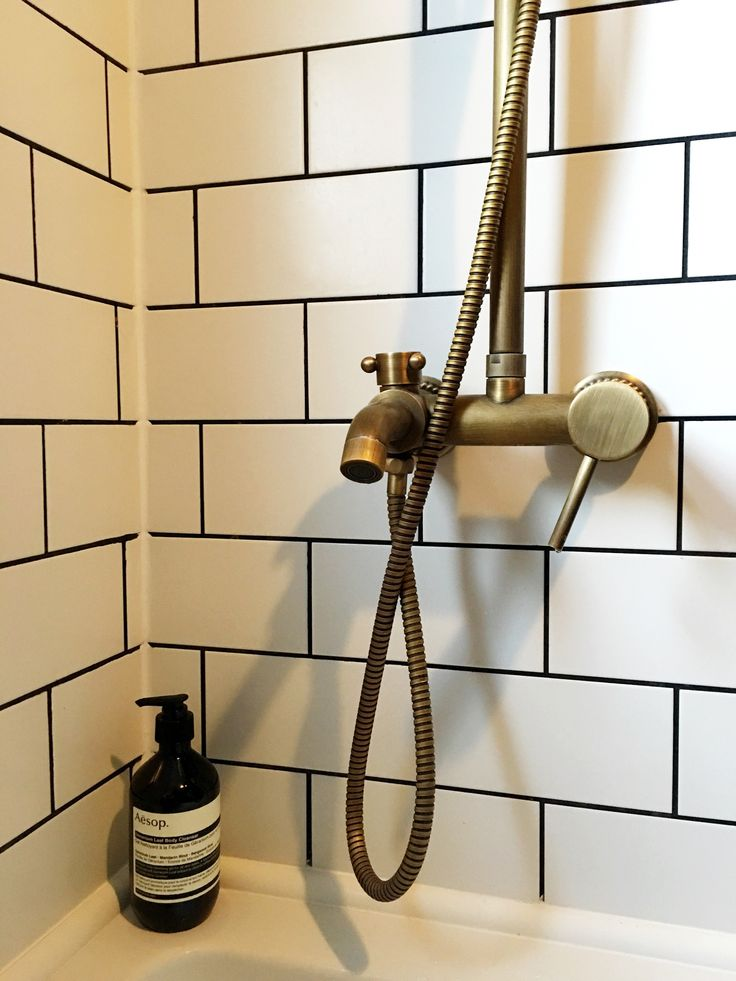 Vintage style antique brass bath taps, white metro tiles, Aesop apothecary. House Tour: Our Blue, Brass metro tile bathroom.