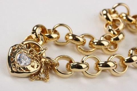 Chunky Belcher Bracelet with Locket Gold – Jewel Online Chunky Belcher Bracelet with Filigree Locket set with CZ. 18 carat gold electroplated over brass. Size 7.5 inches $129.90