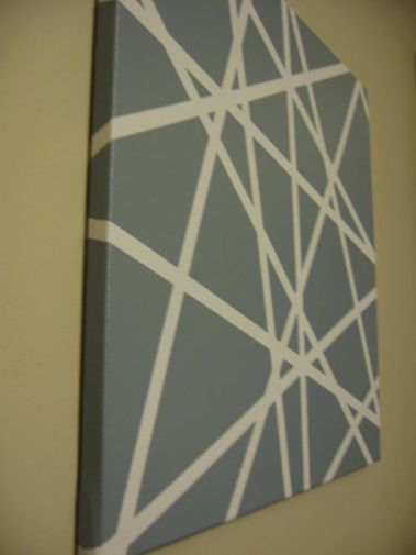 "Canvas, Masking Tape, Spray Paint - So easy! - When I pulled off the tape, it looked a little ""messy."" Some of the spray paint had found its way under the tape. I ended up touching it up with white paint to perfect the lines. It's a great piece of artwork though and it gets tons of compliments."