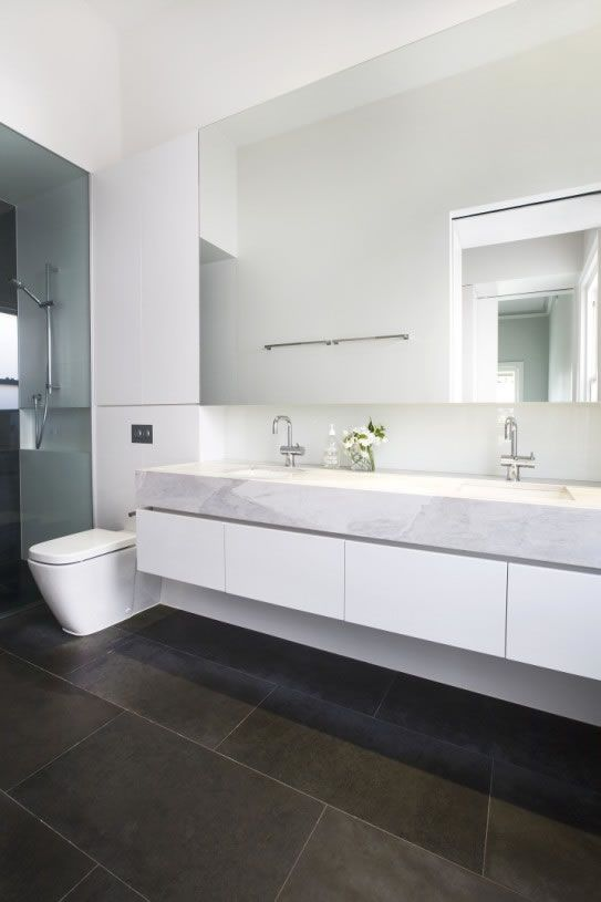 I like most of this bathroom. Would prefer wall mounted faucets. Not sure of the balance between the thick counter and the white band of cabinets below,