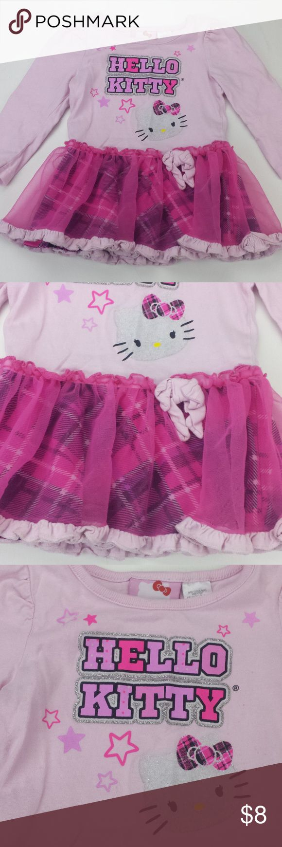 """24 M hello kitty long sleeve tutu J16 Girls 24 month hello kitty long sleeve tutu J16 Size: 24 month Material: body 100% cotton lining - 100% polyester Armpit to Armpit:  10"""" Armpit to cuff: 7"""" Top of Shoulder to Bottom:  15"""" *Measurements are approximate Color may differ slightly than pictured!  Everything is in Excellent used condition, unless stated otherwise. Feel free to comment with any questions you may have! Thanks for looking, and feel free to check out my other listings!! Hello…"""