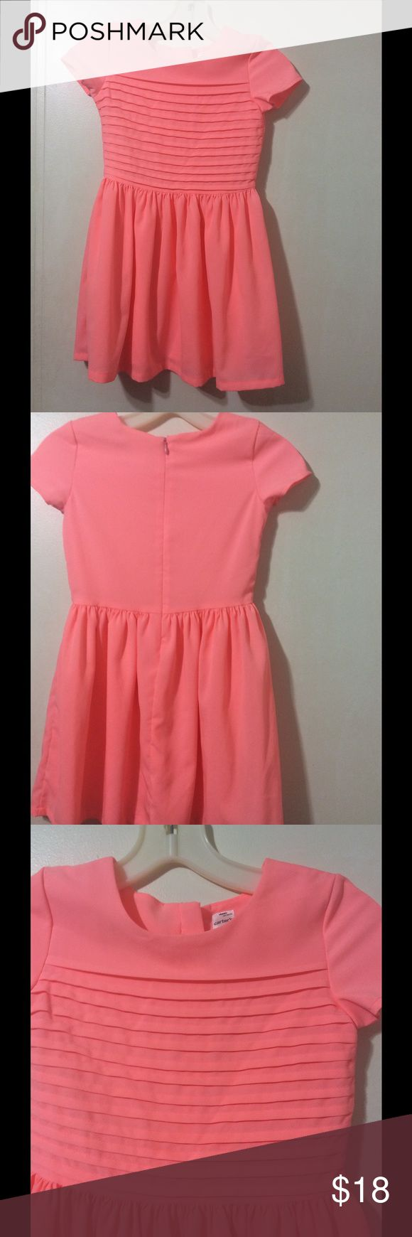 Little girl's neon coral, pleated bodice dress. Carter's size 6 neon coral, pleated bodice dress for the little princess on your life! It's 100% polyester lined dressy dress. Carter's Dresses