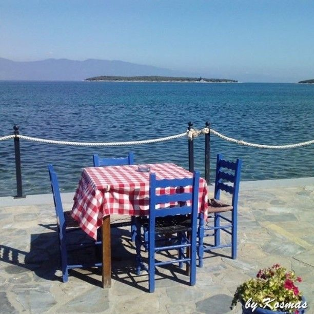 Enjoy this awesome view while eating your meal. Welcome to Greece.  #seaview #Greece #sea #nature #ilovesea #blue #summer #summervacations  #Eatingbythesea