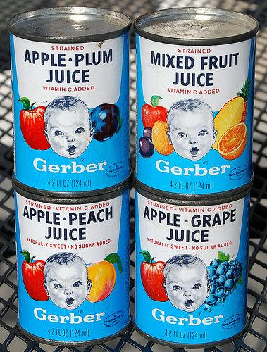 Baby Juice in a can.  Baby Food came this way too.  Long ago the cans had paper labels, and not much color.
