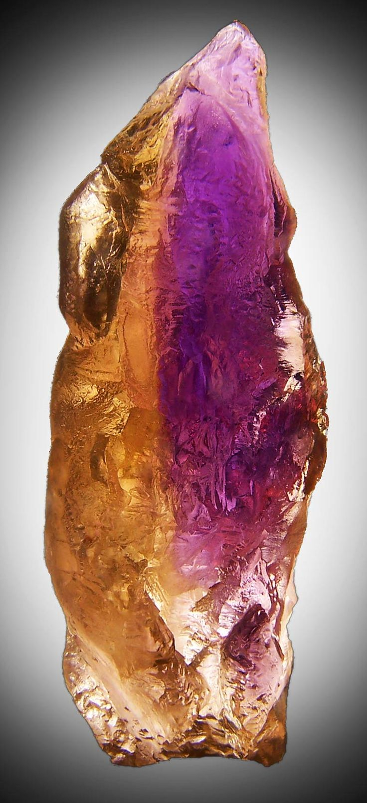 Ametrine ~ Many believe that it contains the powers of amethyst and citrine in one stone, making it a very powerful money stone as well as an excellent via to higher psychic awareness and spiritual enlightenment.