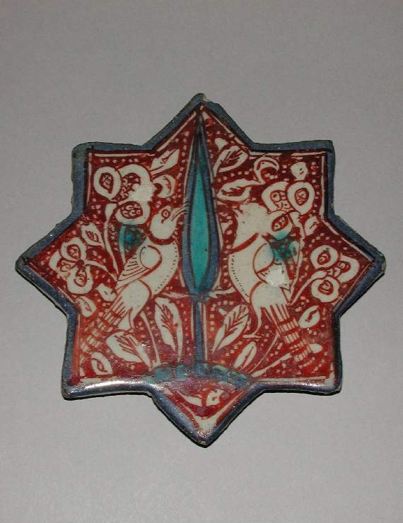 Collection:    Friends of the Fitzwilliam Museum    Category:    fritware (stonepaste)    Name(s):    tile  Islamic pottery; category  lustre ware; category    Other Name:    eight-pointed star tile    Date:    circa 1350 — circa 1400    School/Style:    Il-Khanid    Period:    second half of 13th century