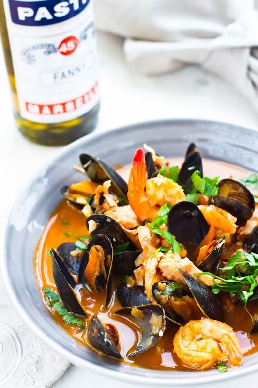 Bouillabaisse: Classic St Tropez & Provençal seafood stew loaded with clams, lobster and fish in a broth delicately flavored with fennel and pastis