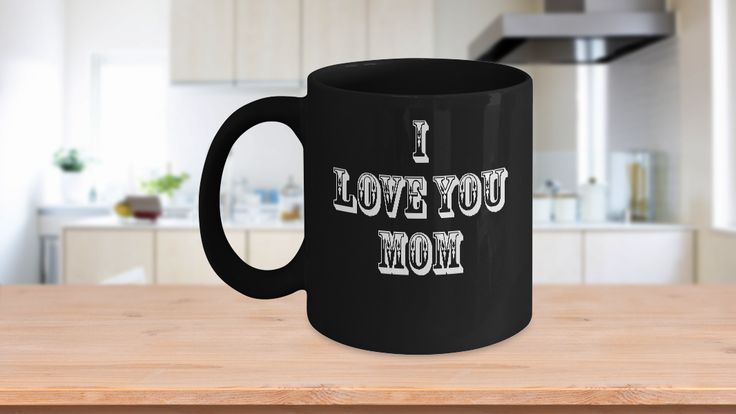 """* JUST RELEASED * This great coffee mug tells your Mom how much you love her. It simply says """"I Love You Mom"""". Tell your Mother how you feel about her this Mother's Day with this special cup. It would also make a good gift for her birthday or Christmas.Cool mugs like this one speak to everyone on a personal level, making them feel special. And it's a functional gift, even if you're not a coffee or tea drinker. It can sit proudly on a desk as a pen holder as well."""