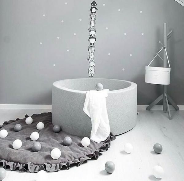 This jersey grey ball pit with white balls is the perfect scandi style baby ball pool.