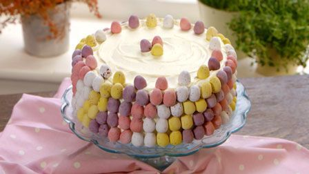 Watch Martha Collison from The Great British Bake Off make this pretty mini egg cake with white chocolate buttercream.