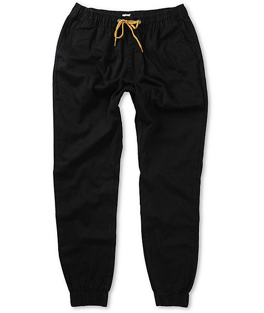 A sleek black slight stretch twill construction provides comfortable mobility with a gusseted drop crotch and elastic ankle cuffs for jogger style.