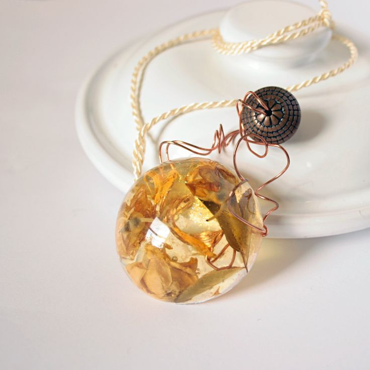 OOAK Necklace -  Yellow cast resin pendant, Banksia rose buds, copper wire and vintage element