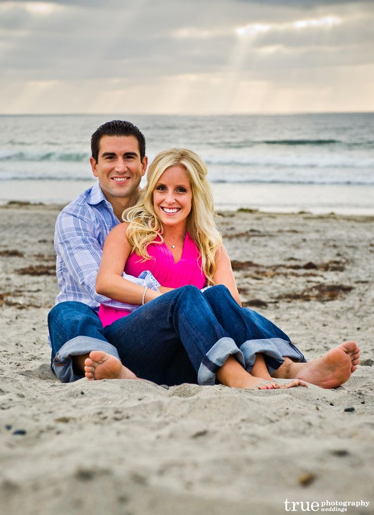 couple on beach with jeans