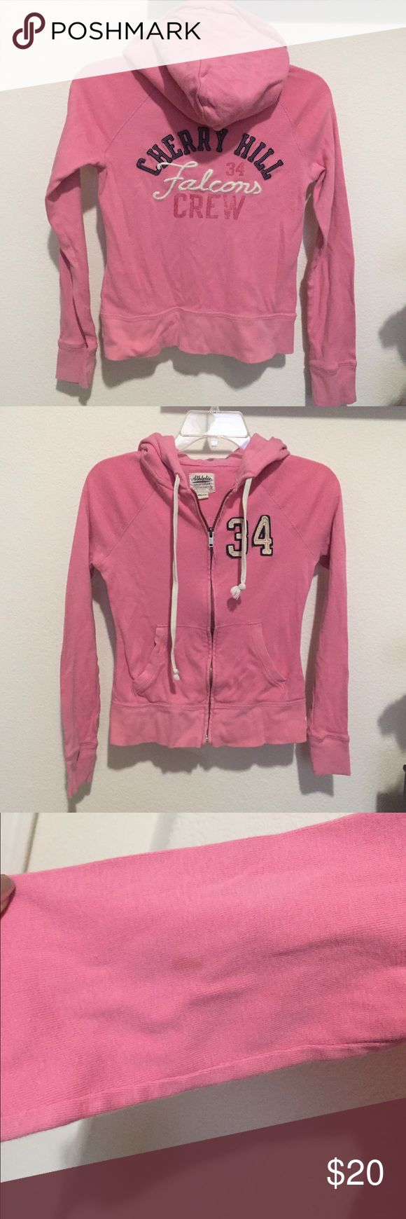 Cherry hill pink zip up jacket American Eagle pink zip up hoodie jacket/sweater. Super cute. Says cherry hill falcons crew on the back along with a number 34. Has a small stain on the arm but it's not noticeable as seen in the picture. American Eagle Outfitters Jackets & Coats