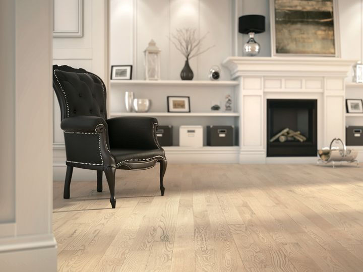 This classic pure living room with white fireplace features Lauzon's Absolut Red Oak hardwood flooring from the Authentik Series. A marvelous light tone wire brushed hardwood flooring that features a character look. This hardwood flooring comes with Pure Genius, Lauzon's new air-purifying smart floor.  #PureGenius #smartfloor #airpurifying #interiordesign #homedecor #Hardwoodflooring #ArtFromNature