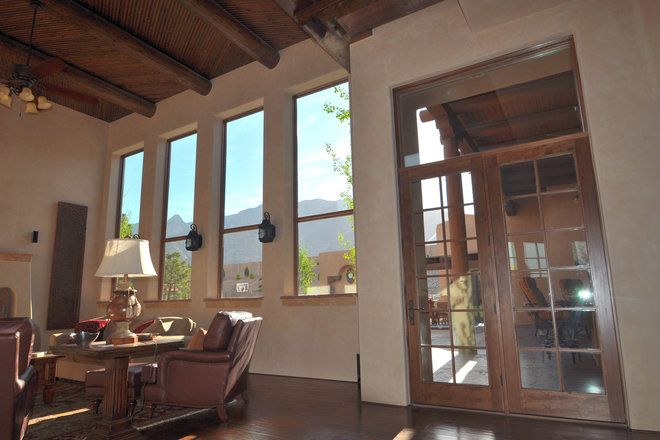 Patio door goals! This beautiful Southwestern home updated their patio style with a new wood hinged French patio door and stunning wood single-hung window replacements to match. https://www.pellabranch.com/albuquerque/projects/french-door-replacement/
