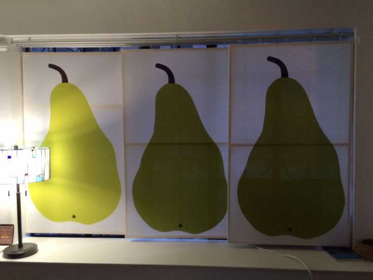 This is a hack of IKEA curtain tracks and homemade Marimekko Pear panels