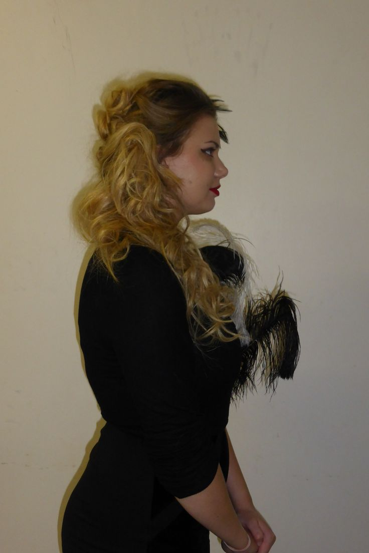 Showing the side of the hairstyle which I created based on the theme of Moulin Rouge/Burlesque. I curled all of the hair first and then brushed it all to the side and used hair grips to keep it in place. I then back combed the fringe and created a small quiff with feathers coming out on the other side.