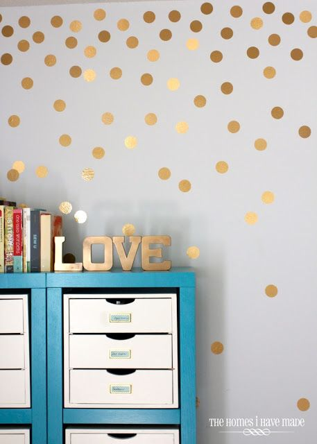 cool dots from gold contact paper for a quick and removable wall treatment! (I also love the storage.)