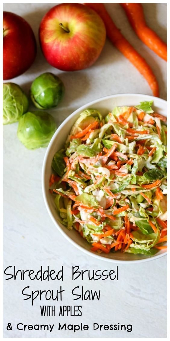Shredded Brussel Sprout Salad with Apples: A tangy light dressing made with Greek yogurt is tossed with sharp shredded Brussel sprouts &sweet apples. Gluten-Free.