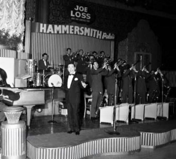 1960, Bandleader Joe Loss is pictured performing with his orchestra.