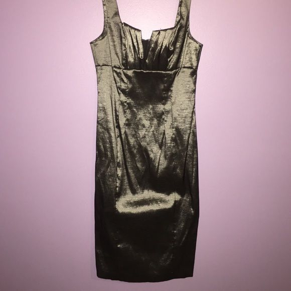 NEVER WORN Gray metallic cocktail dress Metallic and gray. I took the tags off a long time ago, but I've never worn it. Dresses