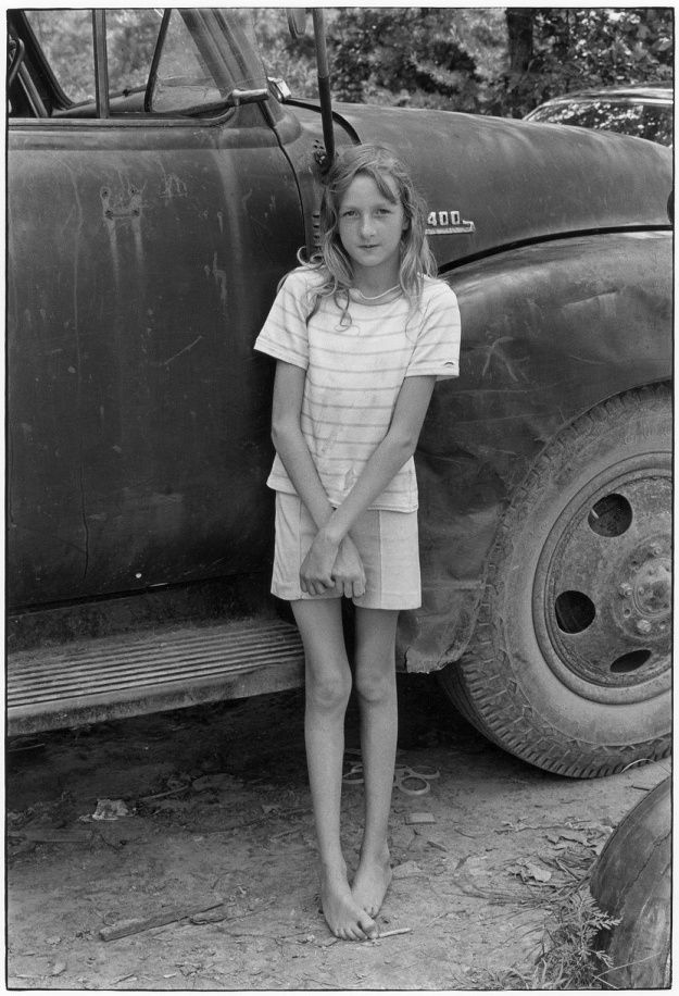 Girl in front of truck.. From Duke Digital Collections. Collection: William Gedney Photographs and Writings. Featured in What Was True: The Photographs and Notebooks of William Gedney, edited by Margaret Sartor, coedited by Geoff Dyer; Featured in retrospective exhibition, Short Distances and Definite Places: The Photographs of William Gedney at the San Francisco Museum of Modern Art (SFMoMA), January 20, 2000 - May 16, 2000; In the permanent collection of the Museum of Modern Art (MoMA)…