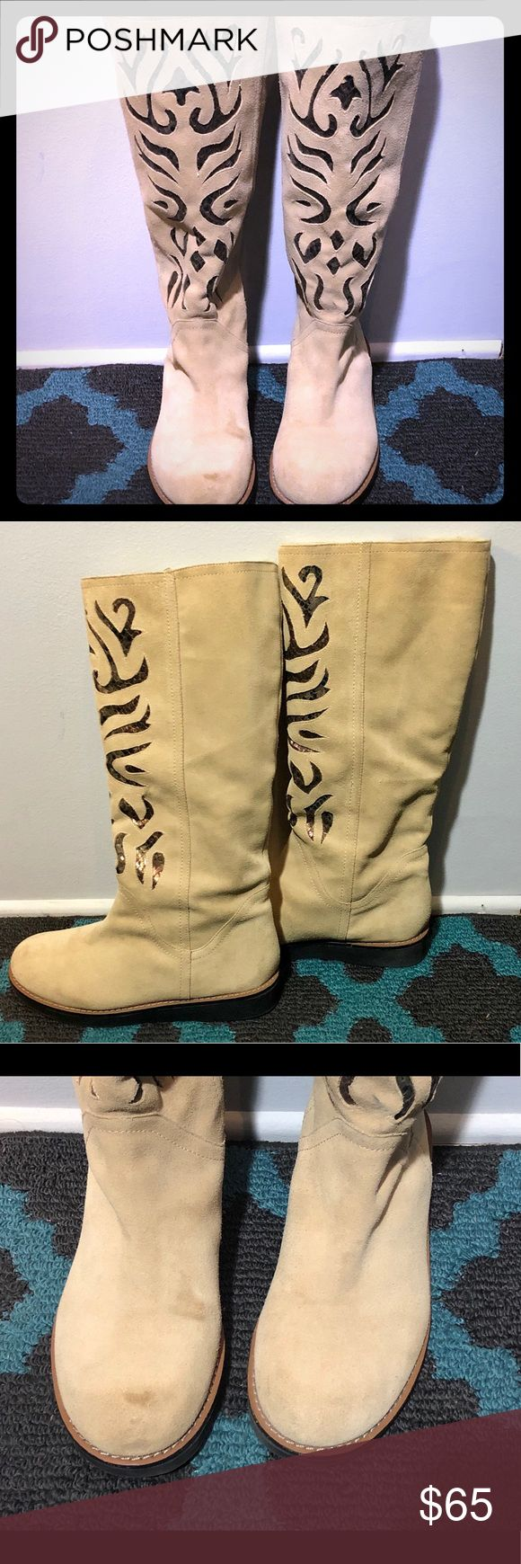 """Carlos Santana boots Suede upper. Faux python inset at laser cut flames. Faux fur lining. Ugg look. Size 7.5. Style: Artista. Low/Flat heel. About 1/2"""" at toe, just over 1"""" at heel. Round toe. Colors: warm taupe (tan) python, golden brown. Rise: from top of sole to top of boot, 16"""". This item is used and in very good condition, some scuffs on right shoe as pictured...Soles show almost no wear. Carlos Santana Shoes Winter & Rain Boots"""