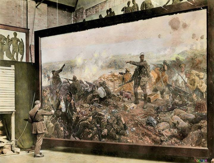 Official war artist Major Richard Jack poses by his painting, c1917. 'The Second Battle of Ypres, 22 April to 25 May 1915' depicting Canadian soldiers making a stand against a German assault.  (National Archives of Canada PA 4879) (Colourised by Royston Leonard from the UK) https://www.facebook.com/pages/Colourized-pictures-of-the-world-wars-and-other-periods-in-time/182158581977012