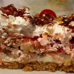 Southern Style Banana Split Cake -   2 cups graham cracker crumbs, 3/4 cup white sugar, 1/4 lbs. butter-melted  2 (8 oz.) pkgs cream cheese, 1 1/2 cups confectioners' sugar, 4 bananas- sliced, 1 (15 oz.) can crushed pineapple-drained, 1 (16 oz.) container Cool Whip-thawed, 1 (16 oz.) jar maraschino cherries, drained, 12 ounces crushed peanuts
