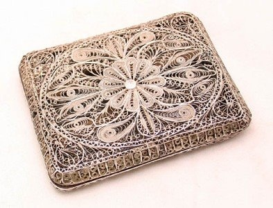 Gah! it looks like filigree styling from Oaxaca! in a box! oh want!