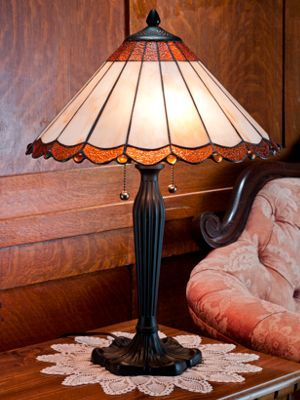 Simple yet elegant stained glass table lamp captures the famed tiffany style with a hand