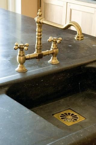 Antiqued Brass Faucet ~ Belgian Bluestone, love how the counter transitions to the sink