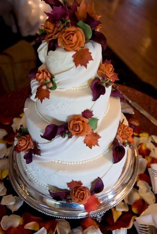 fall wedding cake purple and orange.  trade the roses for something else, though!