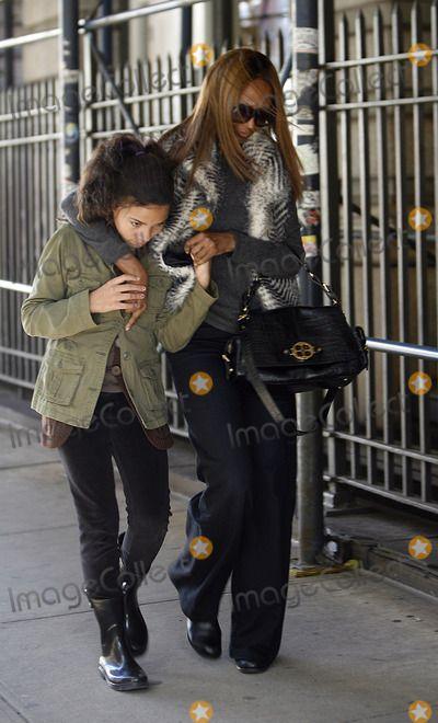 Iman Photo - Model Iman and her daughter Alexandria Zahra Jones walking in Soho on November 4 2011 in New York City