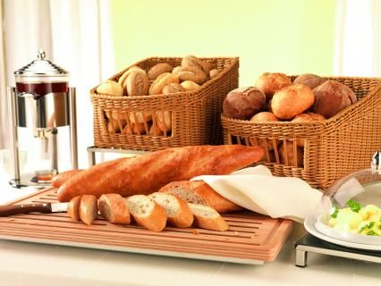 wooden cutting board and bread baskets