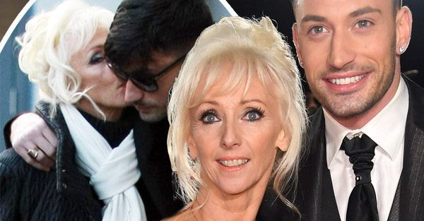 """Debbie McGee kisses Giovanni Pernice at Strictly Tour rehearsals          The formermagician's assistantand hunky dancer looked extremely close as they left theirhotel to attend rehearsals for the upcoming Strictly Come DancingLive Tour 2018 at Arena Birmingham on Tuesday (16 Jan 2018).    Attention!!! This is Just an Announce to view full post click on the """"Visit"""" Button Above"""