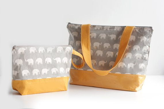 travel diaper pouch and changing pad baby elephant diaper clutch travel changing pad combo. Black Bedroom Furniture Sets. Home Design Ideas