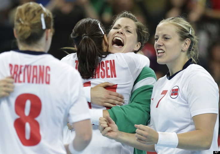 Players of Norway celebrate after winning the women's handball gold medal match against Montenegro at the 2012 Summer Olympics, Saturday, Aug. 11, 2012, in London.