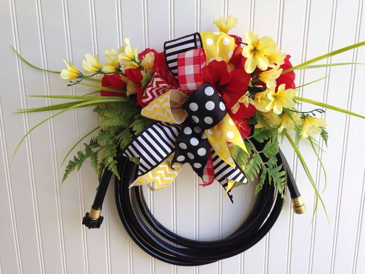 A personal favorite from my Etsy shop https://www.etsy.com/listing/295100119/garden-hose-wreathsummer-waterhose