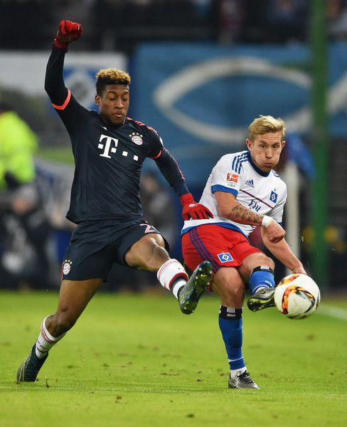 Lewis Holtby of SV Hamburg clears the ball from Kingsley Coman of Bayern Munich during the Bundesliga match between Hamburger SV and FC Bayern Muenchen at Volksparkstadion on January 22, 2016 in Hamburg, Germany.