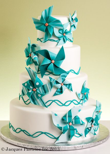 This cake ... with red and blue and yellow and green pinwheels.