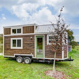 """A 288 sq ft tiny home, named the """"River Runs Through It"""", designed and built by Rocky Mountain Tiny Homes."""
