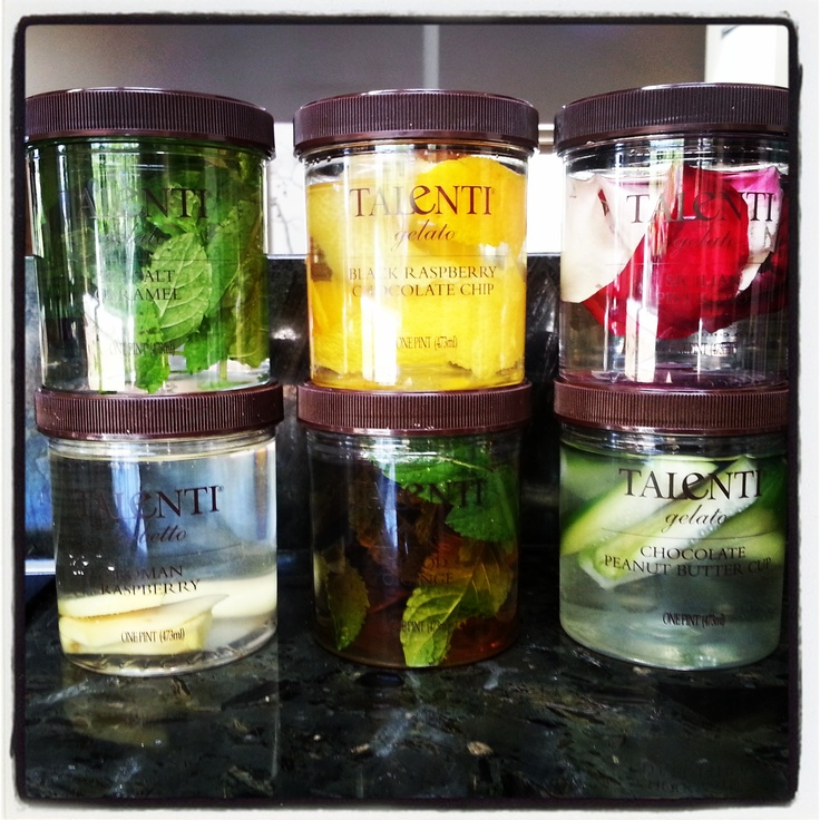 Infusing spirits in empty Talenti containers. Mint, lemon/orange, rose petals, ginger, and cucumber shown here. The dark spirit is rum. Infusing the rum w/mint as a test to see if I can skip a step in my mojito.