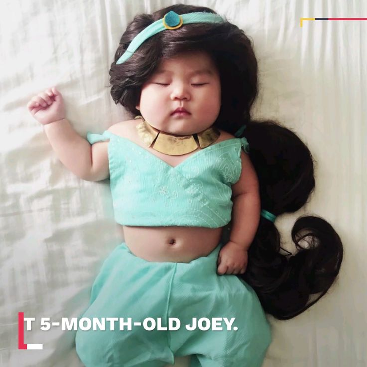 This adorable sleeping baby is a costume queen.