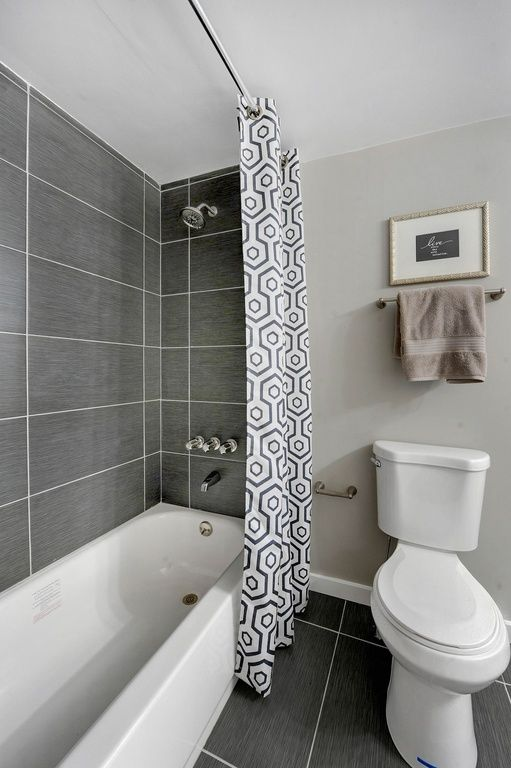 Contemporary Full Bathroom with High ceiling, specialty tile floors, tiled wall showerbath, MS International Graphite