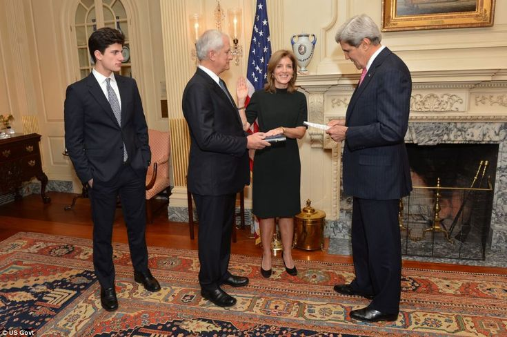 John F Kennedy's grandson John 'Jack' Schlossberg, left, with his mother Caroline Kennedy as she is sworn in as U.S. Ambassador to Japan with her husband Dr Edwin Schlossberg and Secretary of State John Kerry  Read more: http://www.dailymail.co.uk/news/article-2509795/Caroline-Kennedy-gets-royal-treatment-steps-Japan-engagement-ambassador.html#ixzz2lJoRmKNs  Follow us: @MailOnline Pics on Twitter | DailyMail on Facebook