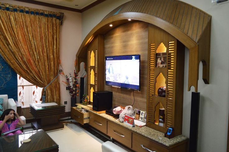 Pakistani home design. Media wall in TV lounge design idea.