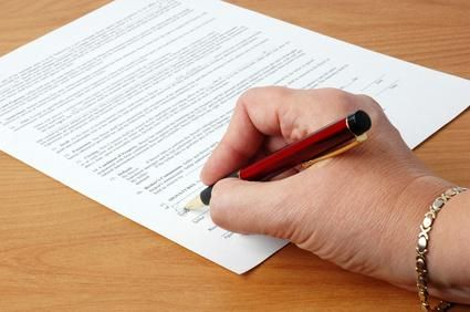 signing a contract image by William Berry from Fotolia.com