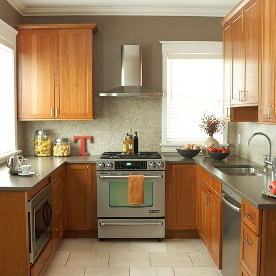 A U-shape layout adds extra counter space to this kitchen. See more kitchen tips: http://www.bhg.com/kitchen/small/maximized-kitchen-footprint/?socsrc=bhgpin072012ushapedkitchen#page=30